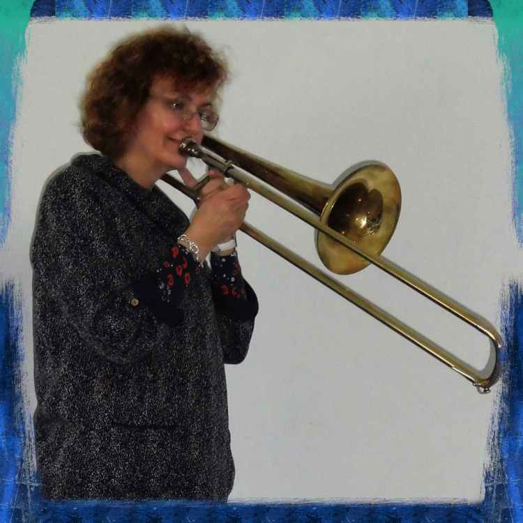 Penny Penelope Tedd, piano, keyboard, cello, trumpet teacher from Bognor Regis, West Sussex, playing the trombone.