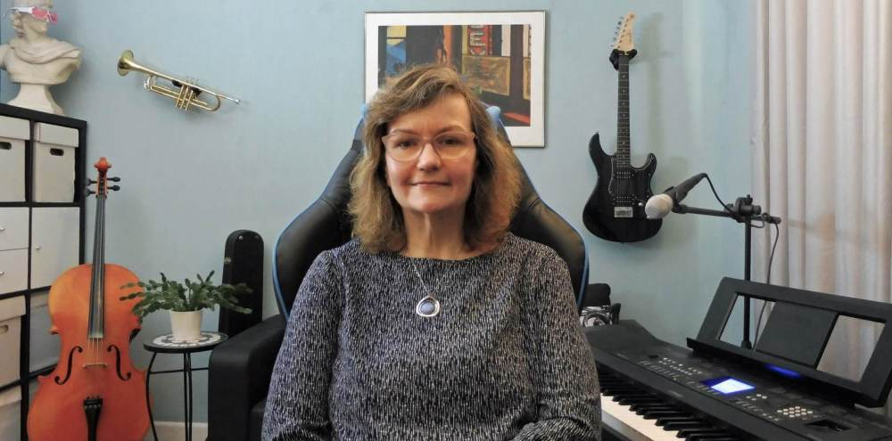 Online teaching music room with piano, keyboard, cello, trumpet, trombone, theory books. Bognor Regis, West Sussex.