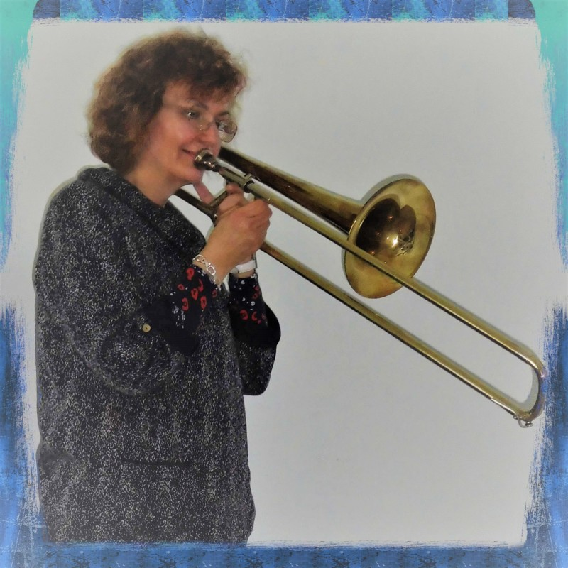 Penny Tedd music teacher, playing the trombone, but not piano, cello, or trumpet in West Sussex.
